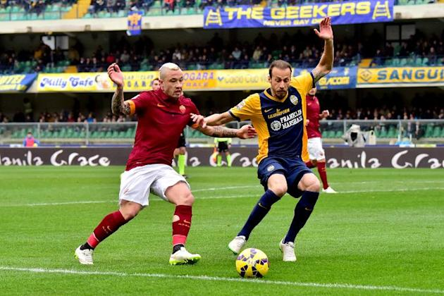 Roma's midfielder from Belgium Radja Nianggolan fights for the ball with Verona's defender from at Bentegodi Stadium in Verona on February 22, 2015