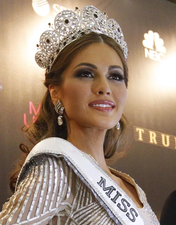 Miss Venezuela Isler poses for photographers at a news conference after winning the Miss Universe 2013 pageant in Moscow