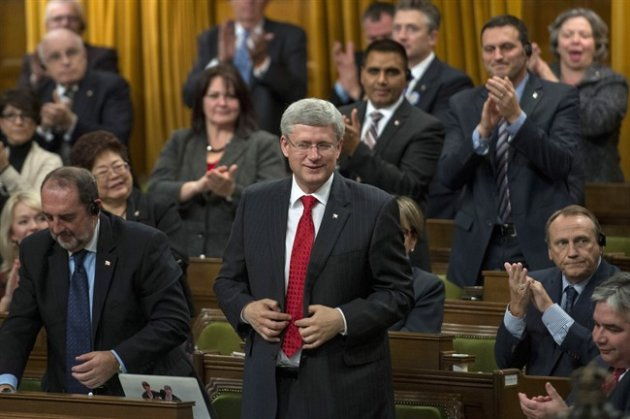 PM Harper rises in the House of Commons to vote for an air combat mission against ISIS on Tuesday. (CP)