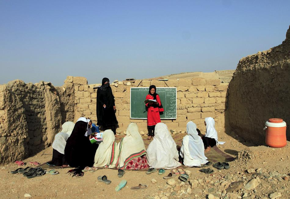 Afghan girls study at an open area, founded by Bangladesh Rural Advancement Committee (BRAC), outside Jalalabad city