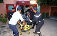 Moroccan rescuers carry the body of a passenger who was killed in a bus crash near Marrakech, in the morgue of the hospital Ibnou Iofail on September 4, 2012. At least 42 people were killed Tuesday when a bus travelling between Marrakesh and Ouarzazate in southern Morocco plunged into a ravine, a security official said