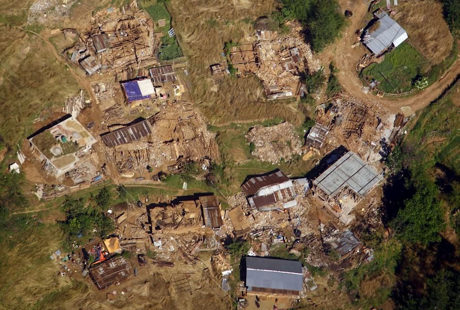 Collapsed village houses are pictured from a helicopter after last week's earthquake at Sindhupalchok District