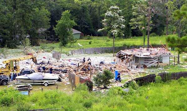 Investigators work the scene of an explosion, Tuesday, July 22, 2014