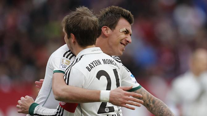 Bayern's Mario Mandzukic of Croatia, left, and Bayern's Philipp Lahm celebrate their side's second goal during a  German first  division Bundesliga  soccer match between 1.FC Nuremberg and Bayern Munich in Nuremberg, Germany, Saturday, Feb. 8, 2014