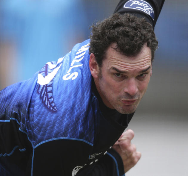 FILE - In this March 28, 2015 file photo, New Zealand's Kyle Mills bowls in the nets during a training for the the Cricket World Cup final in Melbourne, Australia. New Zealand fast bowler Mills has an