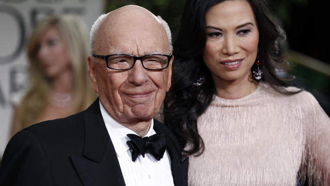 FILE- In this Sunday, Jan. 15, 2012, file photo, Rupert Murdoch and his wife Wendi arrive at the 69th Annual Golden Globe Awards in Los Angeles. Murdoch filed Thursday, June 13, 2013, for divorce from Wendi Deng Murdoch, his wife since 1999.(AP Photo/Matt Sayles, File)