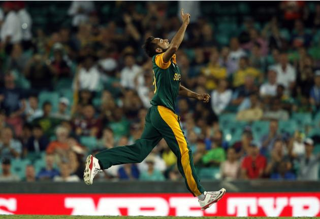 South Africa's Imran Tahir celebrates after bowling West Indies batsman Denesh Ramdin for 22 runs during their Cricket World Cup match at the SCG
