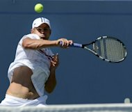 Andy Roddick hits a return against Rhyne Williams of the US during their US open men's first round match in New York on Tuesday. Roddick says the US Open, where he faces Australia's Bernard Tomic in a second-round match Friday at Arthur Ashe Stadium, will be his farewell event