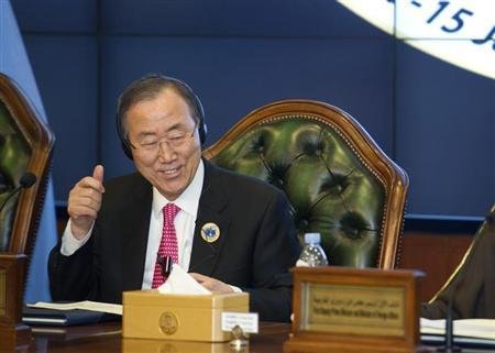 United Nations Secretary-General Ban Ki-Moon gives a thumbs up sign at the end of the Second International Humanitarian Pledging Conference for Syria held at Bayan Palace in Kuwait, January 15, 2014. REUTERS/Stephanie McGehee