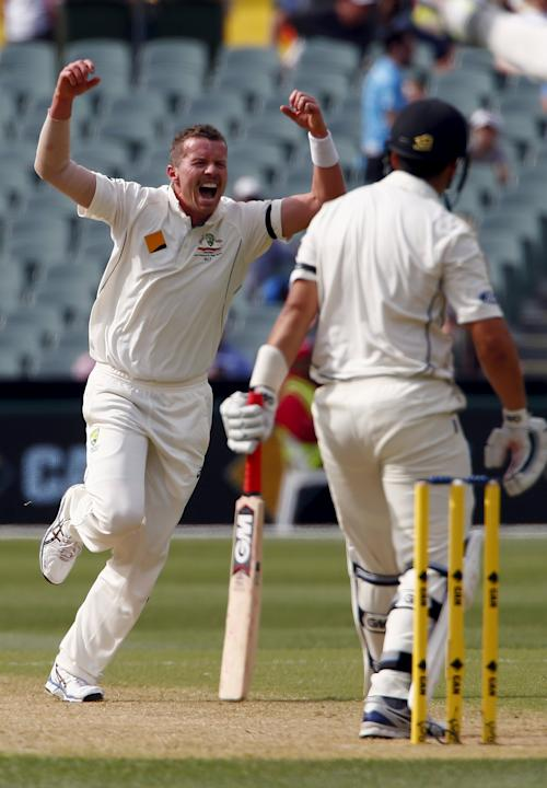 Australia's Peter Siddle celebrates after dismissing New Zealand's Ross Taylor for 21 runs during the first day of the third cricket test match at the Adelaide Oval, in South Australia
