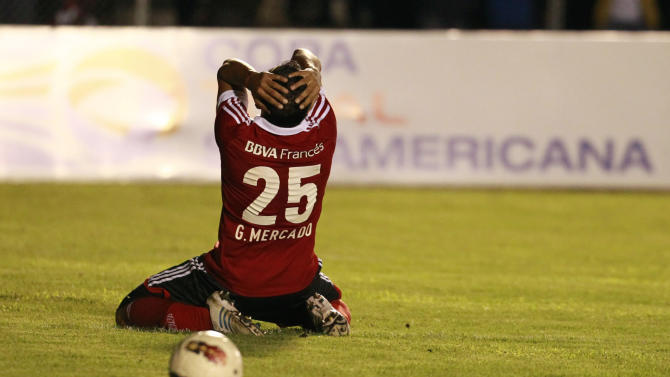 River Plate's Gabriel Mercado of Argentina reacts after he misses a chance to score against Ecuador's Liga Deportiva Universitaria de Loja, in Loja, Ecuador, Thursday, Sept. 19, 2013
