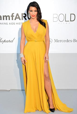Kim Kardashian Flaunts Legs in Canary Yellow Dress at amfAR Gala