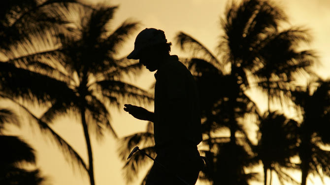 David Hearn of Canada walks off the 10th green after finishing the hole during the first round of the Sony Open golf tournament in Honolulu,