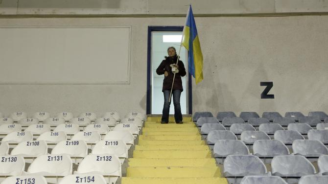 A Ukraine fan stands at a tribune before the start of an international friendly soccer match against the U.S. in Larnaca
