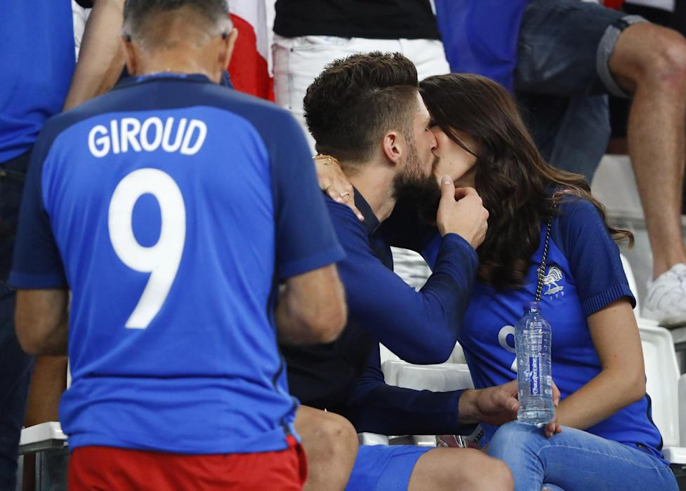 France's Olivier Giroud with partner after the match