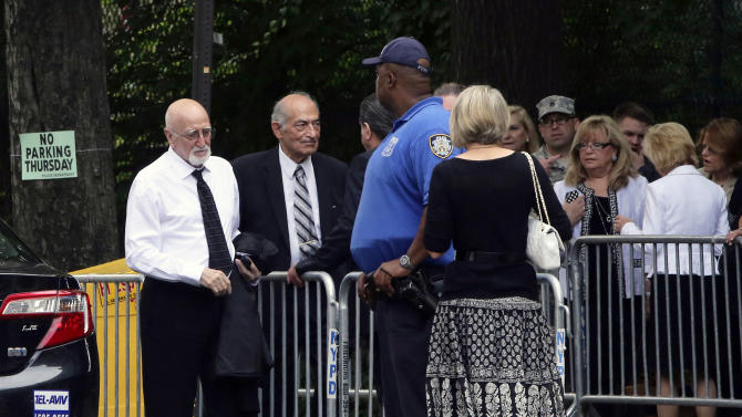 "Actor Dominic Chianese, left, arrives at the the Cathedral Church of Saint John the Divine ahead of the funeral service for James Gandolfini, Thursday, June 27, 2013 in New York. Gandolfini, who played Tony Soprano in the HBO show ""The Sopranos"", died while vacationing in Italy last week. (AP Photo/Mary Altaffer)"