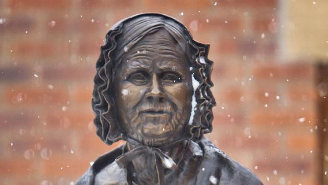 Snowfall begins to accumulate on the statue in the center of Johnson Lummis Hunkins Plaza during springtime snowstorm in Laramie, Wyo., Tuesday, April 9, 2013. The plaza honors the historic women of Laramie and Wyoming and recognizes the state, national and worldwide history they have made through their actions and achievements. (AP Photo/Laramie Boomerang, Jeremy Martin)