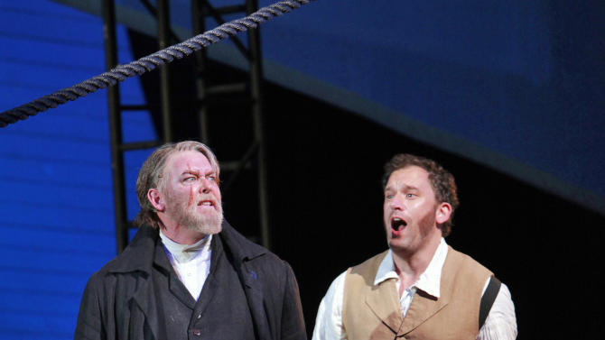 """In this photo taken Oct. 1, 2012 and provided by the San Francisco Opera, Jay Hunter Morris, portraying Captain Ahab, left, and Morgan Smith, portraying Starbuck, perform the opera Moby Dick in San Francisco. """"Moby-Dick,"""" a hit at its premiere in Dallas in 2010 and successfully revived several times since, benefits from a savvy libretto by Gene Scheer, which boils down Melville's sprawling novel to a coherent narrative, while maintaining chunks of his poetic language. (AP Photo/San Francisco Opera, Cory Weaver)"""