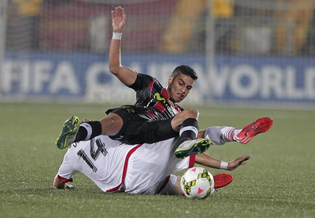 Nick Deleon of D.C. United fights for the ball with Ronald Matarrita of Liga Deportiva Alajuelense during their CONCACAF Champions League soccer match in Alajuela