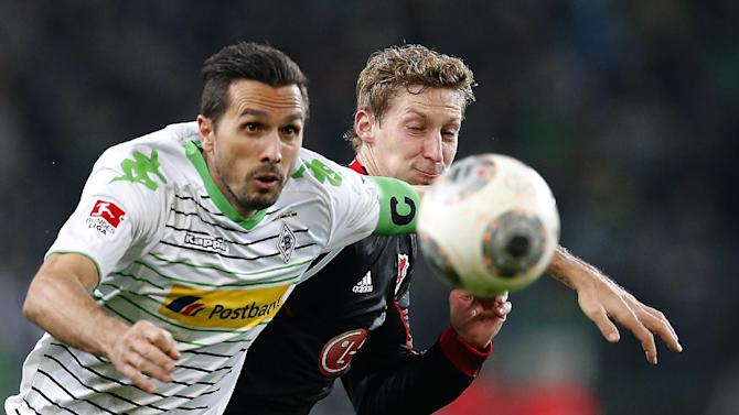 Moenchengladbach's Martin Stranzl of Austria, left, and Leverkusen's Stefan Kiessling challenge for the ball during the German first division Bundesliga soccer match between Borussia Moenchengladbach and Bayer 04 Leverkusen in Moenchengladbach, Germany, Friday, Feb. 7, 2014