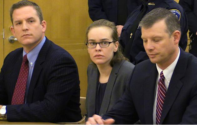 Lacey Spears, flanked by her attorneys David Sachs, left, and Stephen Riebling, Jr., right, looks toward the jury as her guilty verdict is read at the Westchester County Courthouse in White Plains, N.