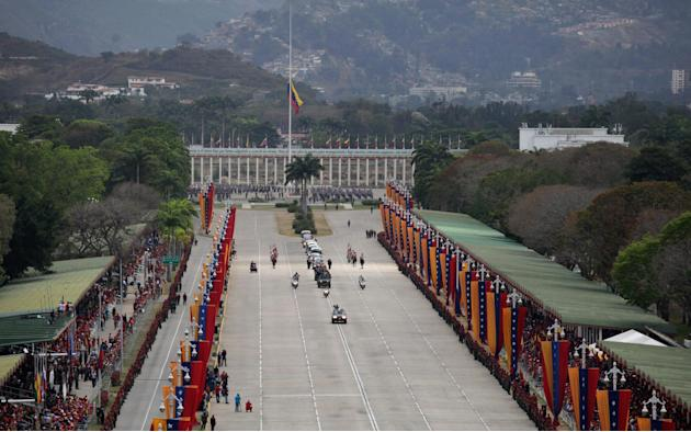 The hearse with the coffin containing the remains of Venezuela's late President Hugo Chavez makes its way from the Fort Tiuna military academy to his final resting place at a military museum  in Carac