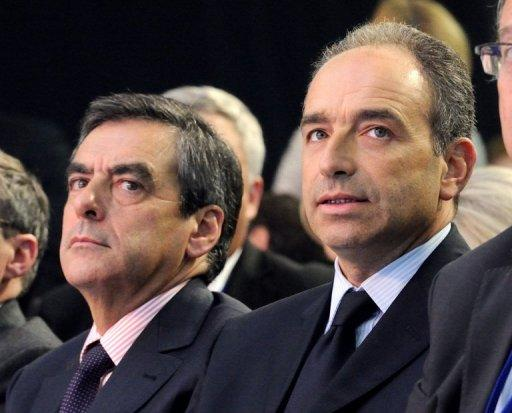 Francois Fillon (L), and his opponent Jean-Francois Cope are pictured on September 27, 2012. The rivals in a bitter leadership row that split France's former ruling party, the rightwing UMP of Nicolas Sarkozy, agreed Monday to a new internal election after a contested first vote last month.