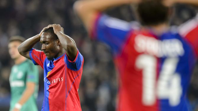 Basel's Valentin Stocker, foreground, and  Giovanni Sio, left, react during the Champions League group E group stage soccer match between Switzerland's FC Basel and Germany's FC Schalke 04 at the St. Jakob-Park stadium in Basel, Switzerland, Tuesday, Oct. 1, 2013