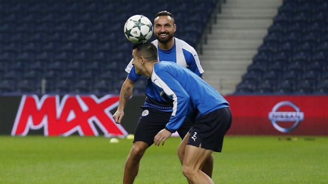 Leicester City's Luis Hernandez and Marcin Wasilewski during training