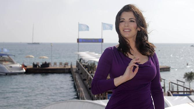 """FILE - In this Oct. 9, 2012 file photo, English food writer, journalist and broadcaster, Nigella Lawson poses during the 28th MIPCOM (International Film and Programme Market for Tv, Video,Cable and Satellite) in Cannes, southeastern France. With a new cookbook, """"Nigellissima,"""" coming on the heels of a new celebrity-rich reality food television show on ABC, the English food star seems intent on leaving a larger mark on the American culinary scene. (AP Photo/Lionel Cironneau, File )"""