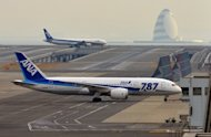An All Nippon Airways' (ANA) Boeing 787 dreamliner is pulled by a towing tractor at Tokyo's Haneda airport on January 16, 2013. Japan plans to impose additional safety requirements on Japanese airlines when it allows them to resume flying the Boeing 787 Dreamliner, a newspaper reported on Friday