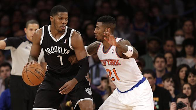 New York Knicks' Iman Shumpert, right, guards Brooklyn Nets' Joe Johnson during the first half of the NBA basketball game at Madison Square Garden, Monday, Jan. 20, 2014, in New York