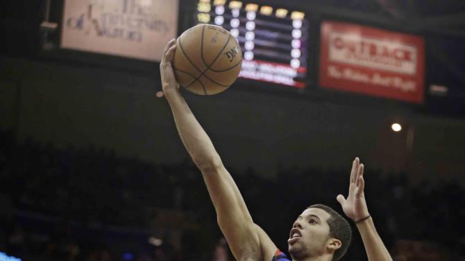 Philadelphia 76ers' Michael Carter-Williams (1) shoots over Cleveland Cavaliers' Kyrie Irving (2) during the first quarter of an NBA basketball game Saturday, Nov. 9, 2013, in Cleveland