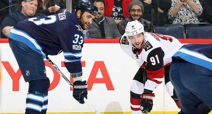 Dustin Byfuglien #33 of the Winnipeg Jets and Alexander Burmistrov #91 of the Arizona Coyotes line up against each other. (Jonathan Kozub/Getty Images)