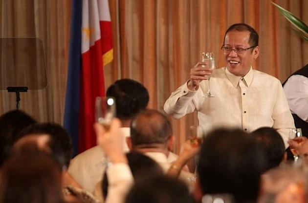 President Benigno S. Aquino III leads the traditional toast for the New Year's Vin d' Honneur at the Rizal Hall, Malacañan Palace on Friday (January 11, 2013). The annual reception, marks the 26th Vin d' Honneur since the 1986 EDSA Revolution, is attended by government officials, members of the Diplomatic Corps, officials of international organizations and businessmen. (Photo by: Lauro Montellano, Jr./MPB/NPPA Images)