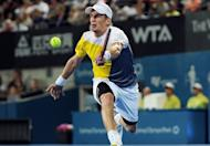 Jarkko Nieminen of Finland returns a shot against Bernard Tomic of Australia during their quarter-final match of the Sydney International tennis tournament on January 10, 2013. Tomic took a major step towards winning his first career ATP Tour title by downing Nieminen at the Sydney International