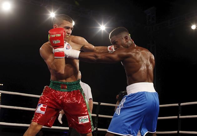 Mohammed Rabii of Morocco Atlas Lions and Muhammad Ali of British Lions Hearts  exchange punches during their WSB boxing flyweight title bout in Casablanca
