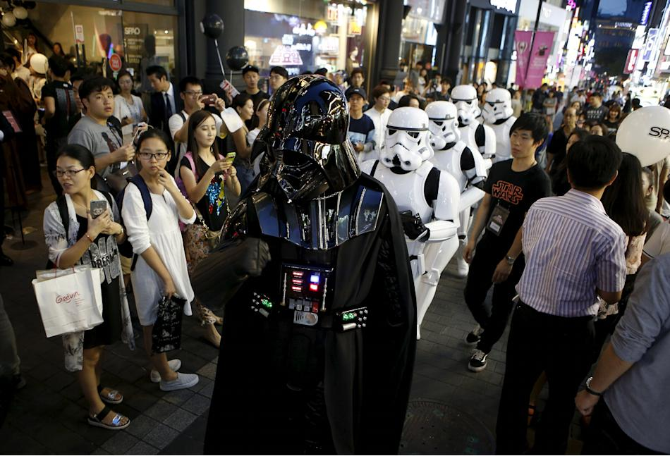 Workers dressed as Darth Vader and Storm Trooper from
