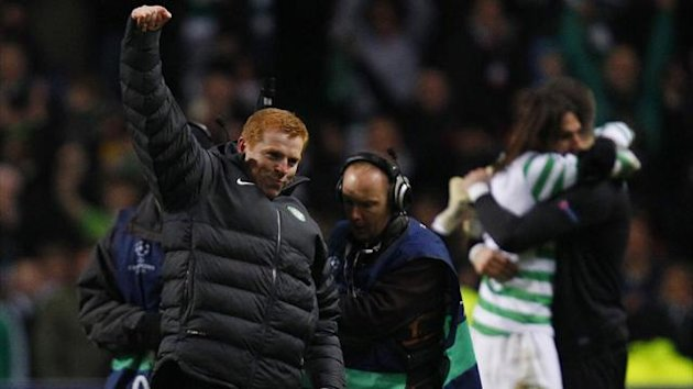 Celtic manager Lennon gestures to fans as he celebrates their victory against Spartak Moscow during their Champions League match in Glasgow