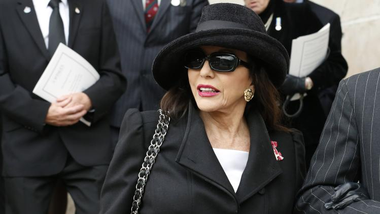 Actress Joan Collins leaves after attending the funeral service of former British Prime Minister Margaret Thatcher at St Paul's Cathedral, in London April 17, 2013. Thatcher, who was Conservative prime minister between 1979 and 1990, died on April 8 at the age of 87.  (AP Photo/Olivia Harris, pool)