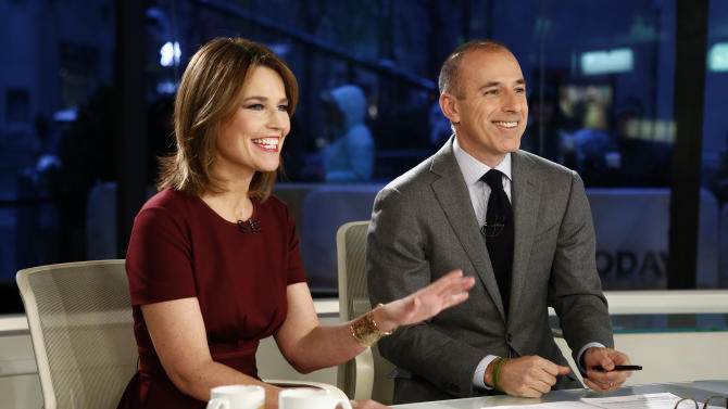 """This Feb. 8, 2013 photo released by NBC shows co-hosts Savannah Guthrie, left, and Matt Lauer during a broadcast of the """"Today"""" show in New York. A top NBC executive says the network is not considering replacing Matt Lauer as anchor of the """"Today"""" show. NBC News executive Alex Wallace, who oversees the troubled morning show, made the comment Wednesday, March 27, 2013, in response to reports that the network had approached CNN's Anderson Cooper about the """"Today"""" job. (AP Photo/NBC, Peter Kramer)"""
