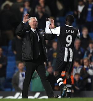 Alan Pardew, left, is hoping Papiss Cisse, right, will be available for selection against Swansea
