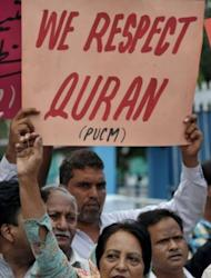 Activists of The Pakistan United Christian Movement shout slogans and carry placards as they protest at a rally for the release of a Christian girl accused of blasphemy in Rawalpindi on September 2. A Pakistani cleric who accused the girl of blasphemy has been remanded in custody on suspicion of evidence-tampering and desecrating the Koran