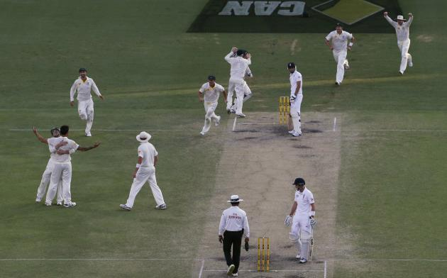 Australia's cricket team celebrates after winning the first Ashes cricket test match against England in Brisbane