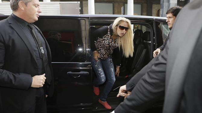Rocio Oliva, girlfriend of Argentina soccer legend Diego Armando Maradona,  arrives in a hotel in downtown Milan, Italy, Thursday, Oct. 17, 2013.  Maradona is in Italy to launch a DVD collection about his life