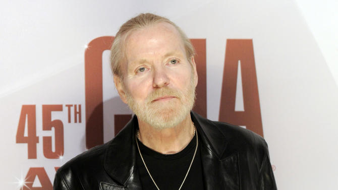 FILE - In this Nov. 9, 2011 file photo, singer Gregg Allman arrives at the 45th Annual CMA Awards in Nashville, Tenn. Rock and Roll Hall of Fame member Gregg Allman is delaying his upcoming book tour for heart tests. Allman is scheduled to undergo tests Friday at The Mayo Clinic in Jacksonville, Fla., the same facility where he underwent a liver transplant in June 2010. (AP Photo/Evan Agostini, file)