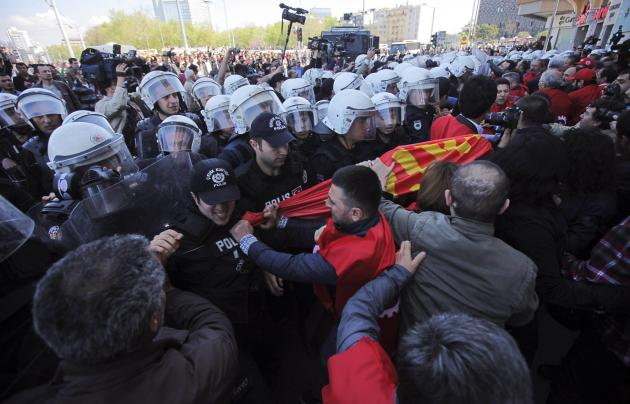 Members of labour unions scuffle with riot police during a protest against the government ban of May Day gathering in Taksim square in central Istanbul