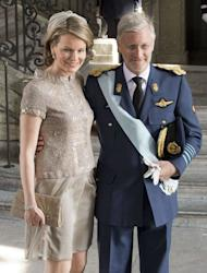 Belgium's Crown Prince Philippe (R) and Princess Mathilde arrive at the Royal Chapel in Stockholm, May 22, 2012
