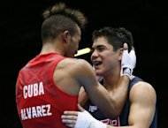 Lazaro Alvarez Estrada (L) of Cuba embraces Joseph Diaz Jr (R) of the USA following their second round Bantamweight (56kg) boxing match of the London 2012 Olympics at the ExCel Arena in London. Alvarez Estrada was awarded a 21-15 points decision