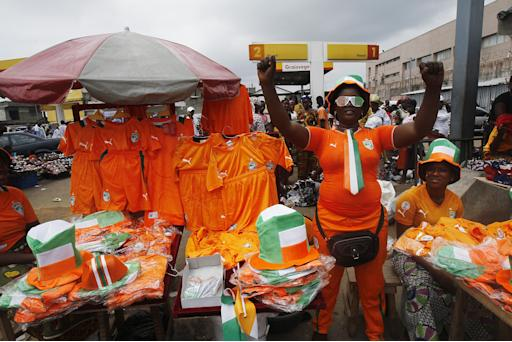 A vendor sells national team merchandise ahead of the Ivory Coast's African Nations Cup final against Ghana, in Abidjan